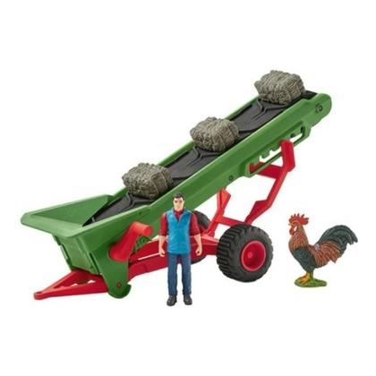 Фермер с конвейером для сена
